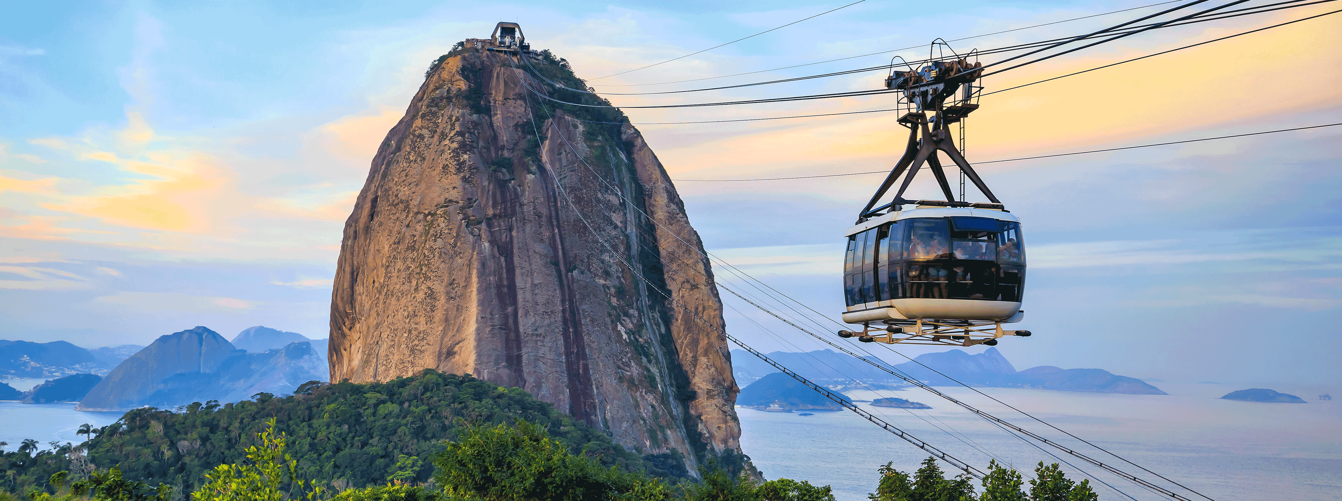 /resource/Images/southamerica/brazil/headerimage/Cable-car-and-Sugar-Loaf-mountain-in-Rio-de-Janeiro.png